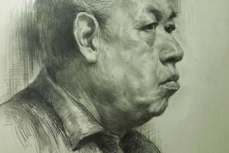 老人头像素描过程阶梯图的正面