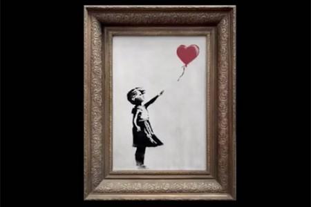"""价值104万英镑的艺术品""""气球女孩""""在交易时自毁了"""